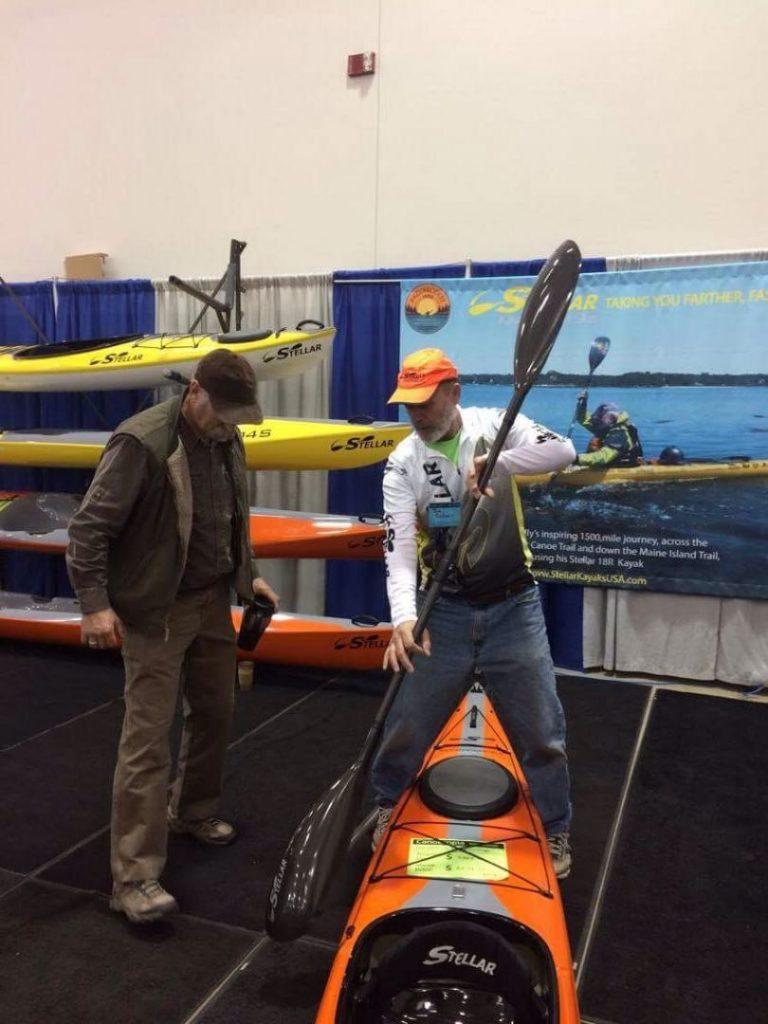 Joe Zellner showing customer how to paddle.