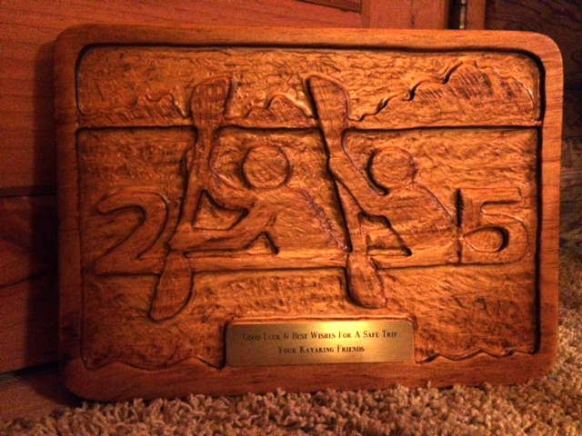 2 Paddling 5 logo on a carved wooden plaque.