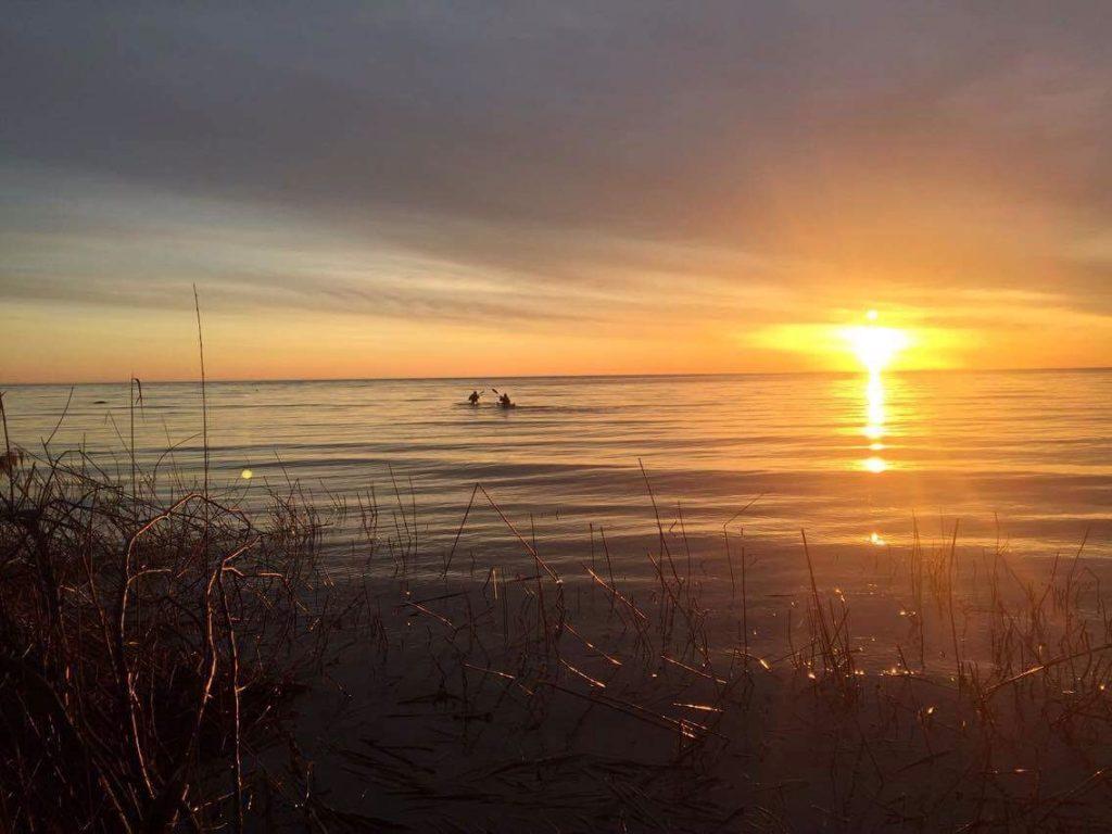 2 Paddling 5 in Michigan on a morning sunrise.