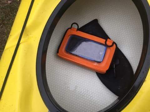 Ugo bag in kayak protects cell phone from water damage.