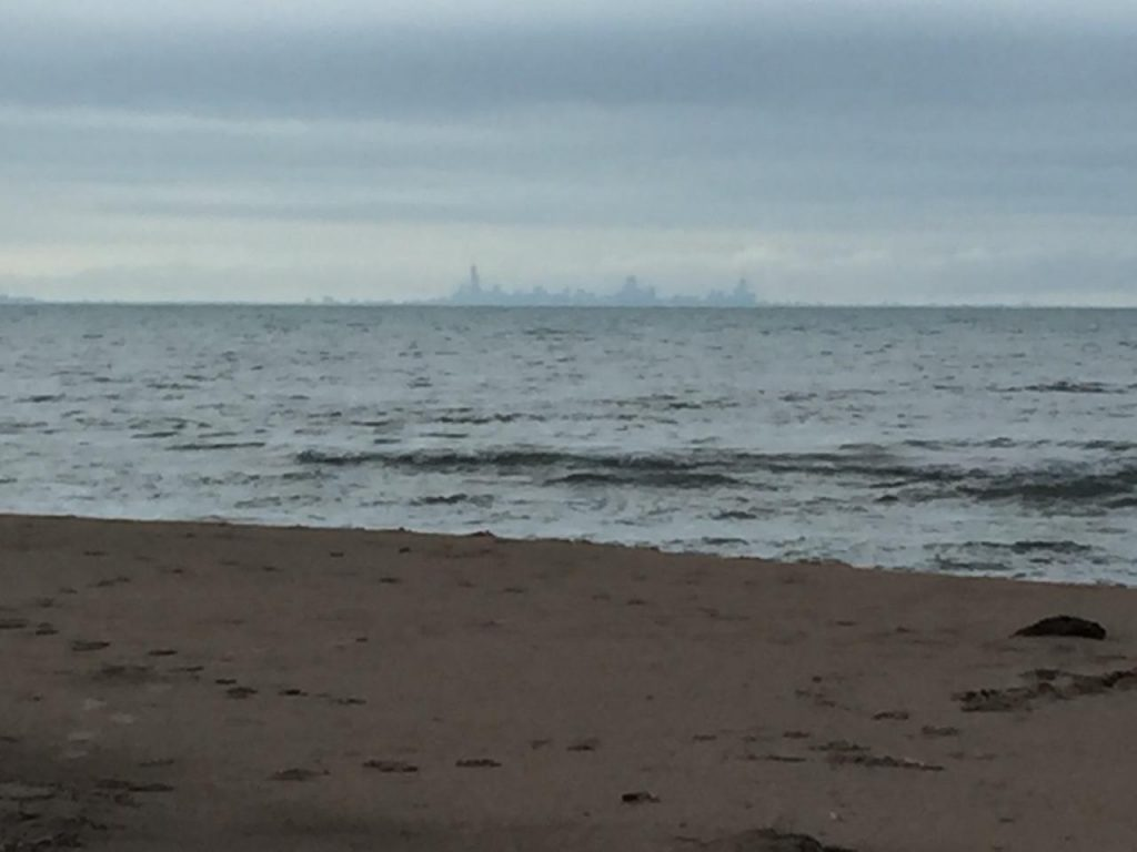 Chicago skyline from a beach across Lake Michigan.