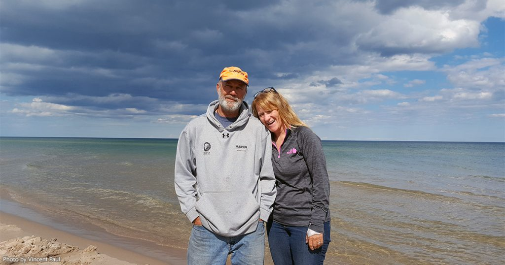 Joe and Peggy from 2 Paddling 5 on the beach of Lake Michigan at Kohler-Andrae State Park.