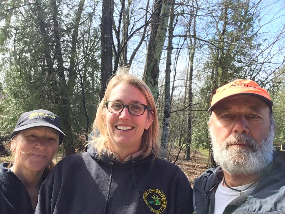 Stephanie Diekema Rosinaki from the DNR at Leelanau State Park posing with Joe and Peggy.