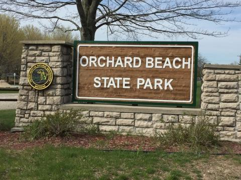 Orchard Beach State Park Michigan sign.