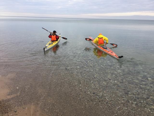 Paddling away on kayaks from Orchard Beach State Park Michigan.