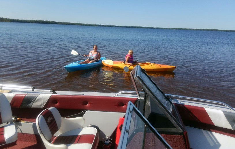 Darrin Teri and family kayaking on Lake Superior.