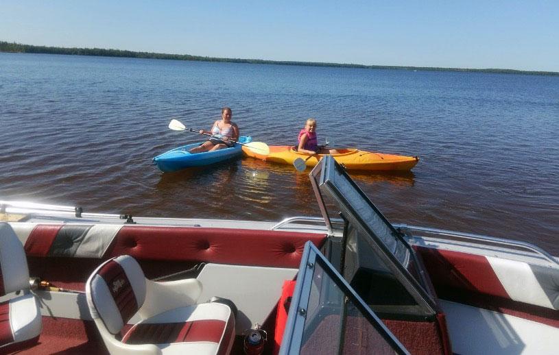 Darrin Teri and family kayaking on Lake Superior.