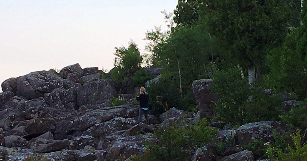Peggy Gabrielson climbing the Tettegouche State Park rocks.