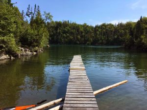 Dock on the Pigeon River, Ontario, Canada.