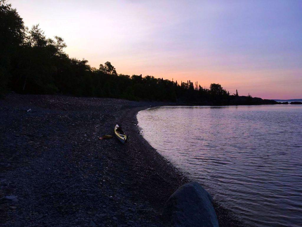 Kayak on shore of Thompson Island, Ontario, Canada.